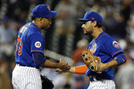 New York Mets' Michael Conforto, right, celebrates with Edwin Diaz after the Mets defeated the Miami Marlins 3-1 in the second game of a baseball doubleheader Tuesday, Aug. 31, 2021, in New York. (AP Photo/Adam Hunger)