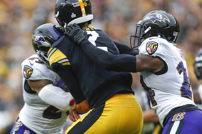 Rudolph exits after scary hit, Ravens edge Steelers in OT