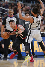 Portland Trail Blazers' C.J. McCollum (3) is called for an offensive foul after colliding with San Antonio Spurs' Patty Mills during the first half of an NBA basketball game, Saturday, Nov. 16, 2019, in San Antonio. (AP Photo/Darren Abate)