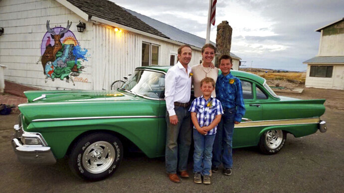 This recent photo provided by Jasmine Tool shows herself with her fiance Daniel Jastrab and their sons Jameson, right, and Silas. Tool, an ailing U.S. Fish and Wildlife Service worker in Oregon, says she can't learn why her federally paid insurance lapsed months ago or get it reinstated because of the partial government shutdown. Tool is now scrambling to find a way to pay for nutrients that keep her alive. (Jasmine Tool via AP)