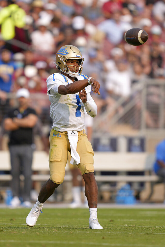 UCLA quarterback Dorian Thompson-Robinson (1) throws a pass against the Stanford during the first half of an NCAA college football game Saturday, Sept. 25, 2021, in Stanford, Calif. (AP Photo/Tony Avelar)