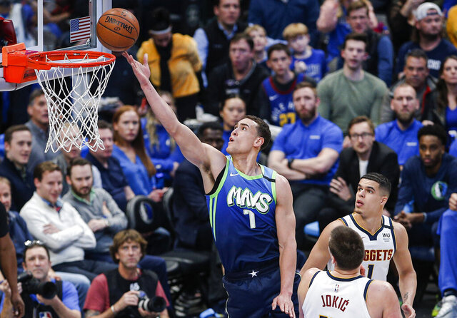 Dallas Mavericks forward Dwight Powell (7) attempts a layup during the first half of the team's NBA basketball game against the Denver Nuggets on Wednesday, Jan. 8, 2020, in Dallas. (AP Photo/Brandon Wade)