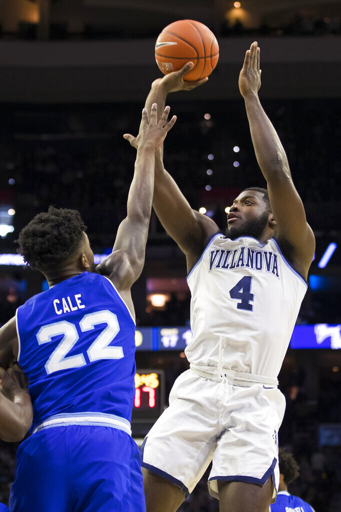 Villanova's Eric Paschall, right, shoots against Seton Hall's Myles Cale, left, during the first half of an NCAA college basketball game, Sunday, Jan. 27, 2019, in Philadelphia. (AP Photo/Chris Szagola)