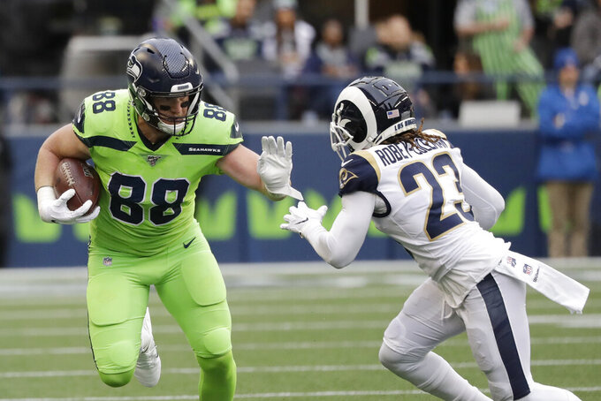 Seattle Seahawks tight end Will Dissly (88) rushes against Los Angeles Rams defensive back Nickell Robey-Coleman during the first half of an NFL football game Thursday, Oct. 3, 2019, in Seattle. (AP Photo/Elaine Thompson)