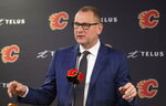 Calgary Flames general manager Brad Treliving announces the resignation of head coach Bill Peters at an NHL hockey press conference in Calgary, Alberta, Friday, Nov. 29, 2019. (Larry MacDougal/The Canadian Press via AP)