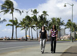 FILE - In this Dec. 19, 2011 file photo, Diane Cervelli, left, and Taeko Bufford, right, walk past Waikiki beach in Honolulu. The U.S. Supreme Court is rejecting an appeal from a Hawaii bed and breakfast that wouldn't rent a room to the lesbian couple. The justices on Monday, March 18, 2019 left in place Hawaii state court rulings that found the Aloha Bed & Breakfast in Honolulu violated Hawaii's anti-discrimination law by turning the couple away. Owner Phyllis Young had argued she should be allowed to turn away gay couples because of her religious beliefs. (AP Photo/Eric Risberg, File)