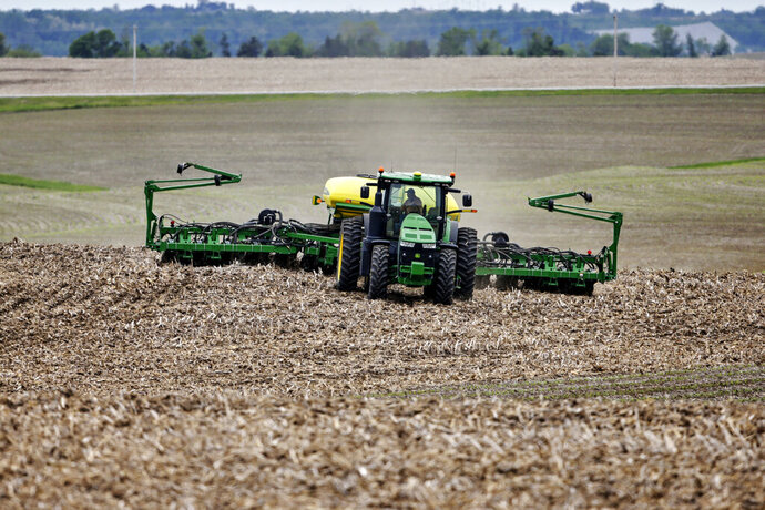In this May 23, 2019, photo a farmer plants soybeans in a field in Springfield, Neb. On Friday, July 12, the Labor Department reports on U.S. producer price inflation in June. (AP Photo/Nati Harnik)