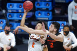 Oklahoma State guard Cade Cunningham (2) shoots on Oregon State center Roman Silva (12) during the second half of a men's college basketball game in the second round of the NCAA tournament at Hinkle Fieldhouse in Indianapolis, Sunday, March 21, 2021. (AP Photo/Paul Sancya)
