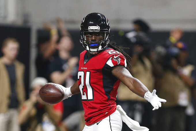 FILE - In this Sept. 15, 2019, file photo, Atlanta Falcons cornerback Desmond Trufant (21) celebrates after making an interception during an NFL football game against the Philadelphia Eagles in Atlanta. The Atlanta Falcons will dramatically boost their financial flexibility by releasing three high-priced veterans _ running back Devonta Freeman, cornerback Desmond Trufant and offensive tackle Ty Sambrailo. The Falcons announced the Sambrailo move on Monday, March 16, 2020. The team is finalizing the moves with Freeman and Trufant, former Pro Bowl players who had been considered foundation players for the franchise. (AP Photo/Michael Zarrilli, Fle))