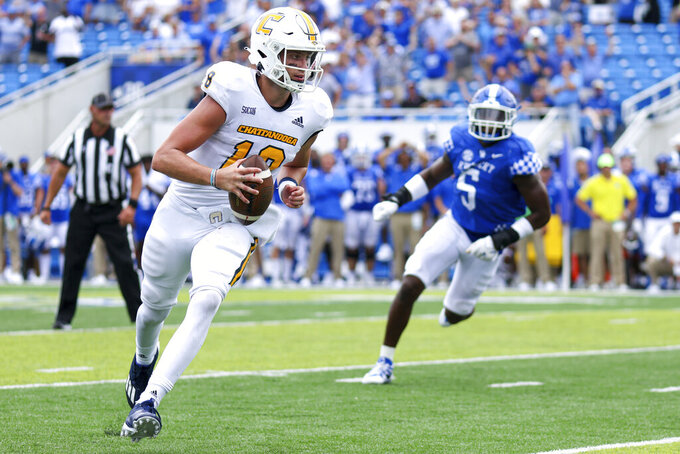 Chattanooga quarterback Cole Copeland (18) runs the ball into the end zone during the second half of a NCAA college football game against Kentucky in Lexington, Ky., Saturday, Sept. 18, 2021. (AP Photo/Michael Clubb)