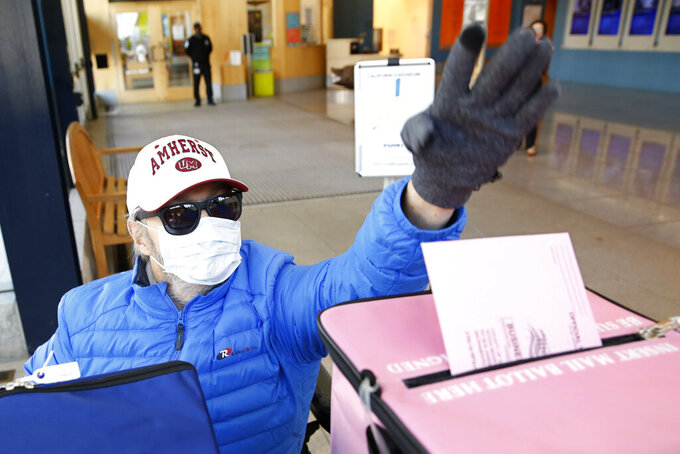 "FILE - In this Monday, March 2, 2020 file photo, a man wearing a mask as a precaution against passing or receiving germs casts his ballot on the eve of Super Tuesday, at a voting center in Sacramento, Calif. On Friday, June 19, 2020, The Associated Press reported on stories circulating online incorrectly asserting all California registered to vote as an independent will not be able to vote Republican in 2020. Information contained in the post does not apply to the general election this fall. During California's presidential primary election on March 3, independent voters, also known as ""no party preference"" voters, could vote in the Democratic presidential primary without changing their party affiliation, but not in the Republican primary. (AP Photo/Rich Pedroncelli)"