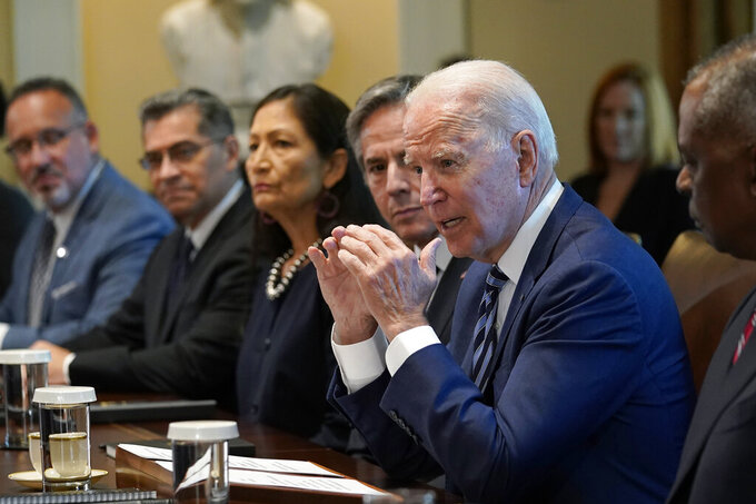 President Joe Biden speaks during a meeting with his Cabinet in the Cabinet Room at the White House in Washington, Tuesday, July 20, 2021. From left, Secretary of Education Miguel Cardona, Secretary of Health and Human Services Xavier Becerra, Secretary of the Interior Deb Haaland, Secretary of State Antony Blinken, Biden and Secretary of Defense Lloyd Austin. (AP Photo/Susan Walsh)