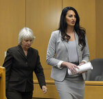 Prosecuting attorney Barbara Lachmar, left, and defense attorney Skye Lazaro enter the courtroom ahead of the day's testimony in the rape trial of former NCAA college football player Torrey Green, Tuesday, Jan. 15, 2019, in Brigham City, Utah. Green is accused of raping multiple women while he was a football player at Utah State. (Eli Lucero/The Herald Journal via AP)