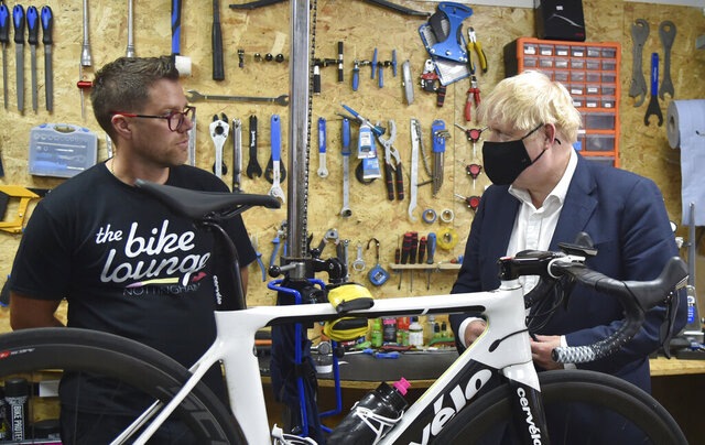 Britain's Prime Minister Boris Johnson at the Canal Side Heritage Centre in Beeston near Nottingham, England, Tuesday, July 28, 2020. The government is launching a new cycling intuitive to help get people fitter. (AP Photo/Rui Vieira, Pool)