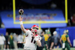Georgia quarterback Jake Fromm warms up for the team's Sugar Bowl NCAA college football game against Baylor in New Orleans, Wednesday, Jan. 1, 2020. (AP Photo/Gerald Herbert)