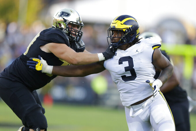 File-This Sept. 23, 2017, file photo shows Michigan defensive lineman Rashan Gary (3) being blocked by Purdue offensive lineman Matt McCann (79) during the second half of an NCAA college football game in West Lafayette, Ind. Gary, one of the most athletically gifted players in the college game, had 12 TFLs and six sacks.  (AP Photo/Michael Conroy, File)