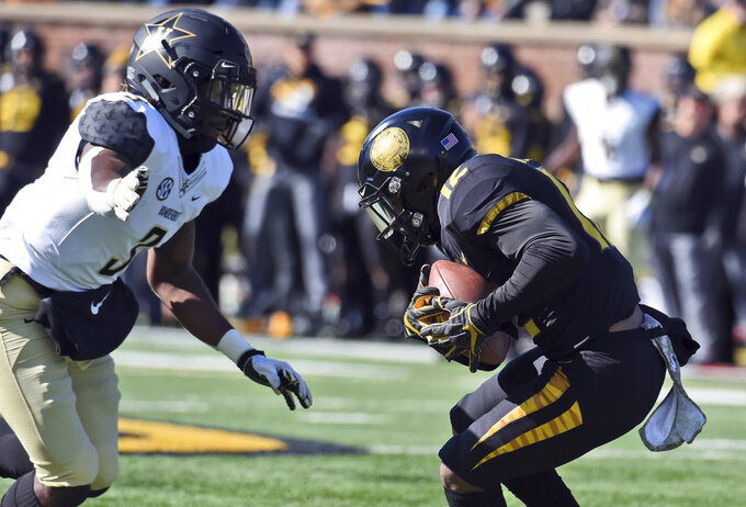 Missouri wide receiver Johnathon Johnson, right, catches a pass as Vanderbilt defensive back Tae Daley closes in during the first half of an NCAA college football game Saturday, Nov. 10, 2018, in Columbia, Mo. (AP Photo/L.G. Patterson)