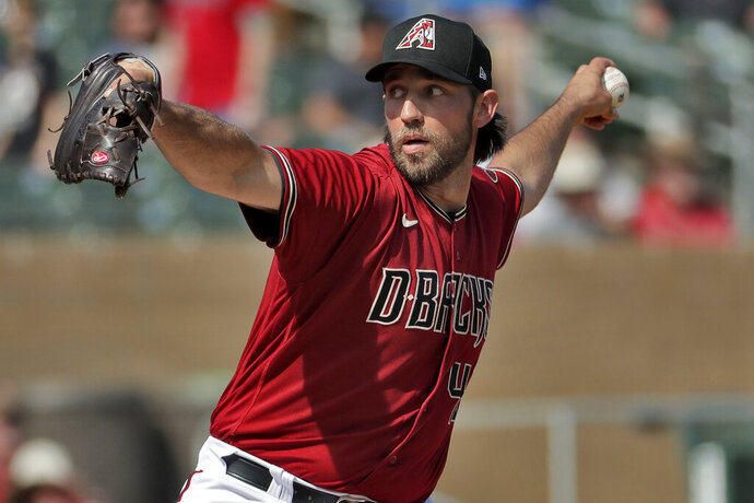 FILE - In this Feb. 27, 2020, file photo, Arizona Diamondbacks pitcher Madison Bumgarner throws during the second inning of spring training baseball game against the Cincinnati Reds in Scottsdale Ariz. Arizona's new pitching addition Bumgarner threw two innings of live batting practice on Saturday, July 4, 2020. It was his first outing during the team's summer camp at Chase Field as the D-backs prepare for a 60-game season. (AP Photo/Matt York, File)