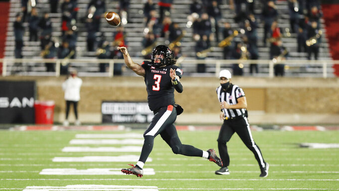 Texas Tech quarterback Henry Colombi throws a pass during the second half of the team's NCAA college football game against Oklahoma, Saturday, Oct. 31, 2020, in Lubbock, Texas. (AP Photo/Mark Rogers)