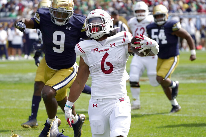 Wisconsin running back Chez Mellusi carries the ball during the second half of an NCAA college football game against Notre Dame Saturday, Sept. 25, 2021, in Chicago. Notre Dame won 41-13. (AP Photo/Charles Rex Arbogast)