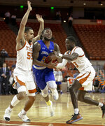 South Dakota State guard David Jenkins (5) tries to split through Texas guards Elijah Mitrou-Long (55) and Courtney Ramey (3) during a first round game of the NCAA college basketball National Invitation Tournament in Austin, Texas, Tuesday, March 19, 2019. (Nick Wagner/Austin American-Statesman via AP)