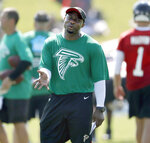 FILE - In this July 27, 2018, file photo, Atlanta Falcons defensive coordinator Marquand Manuel stands on the field at an NFL football training camp practice in Flowery Branch, Ga.  The scoreboard at Mercedes-Benz Stadium figures to get a workout Sunday in the matchup between NFC South rivals. Tampa Bay (2-2) has surrendered more points per game than any team in the league (34.75), while the Falcons (1-4) are right on their heels with an average of 32.6.(AP Photo/David Goldman, File)