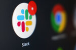 The Slack app icon is displayed on a computer screen, Wednesday, Dec 2, 2020, in Tokyo. In a deal announced Tuesday, Dec. 1, 2020, business software pioneer Salesforce.com is buying work-chatting service Slack for $27.7 billion in a deal aimed at giving the two companies a better shot at competing against longtime industry powerhouse Microsoft. (AP Photo/Kiichiro Sato)