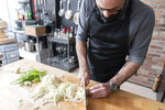 In this Oct. 7, 2020 photo, Andrew Rea, founder of the Binging with Babish network, chops a fennel as he tapes an episode of