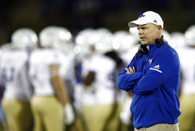Tulsa head coach Philip Montgomery stands on the field in the second half of an NCAA college football game against Navy, Saturday, Nov. 17, 2018, in Annapolis, Md. (AP Photo/Patrick Semansky)