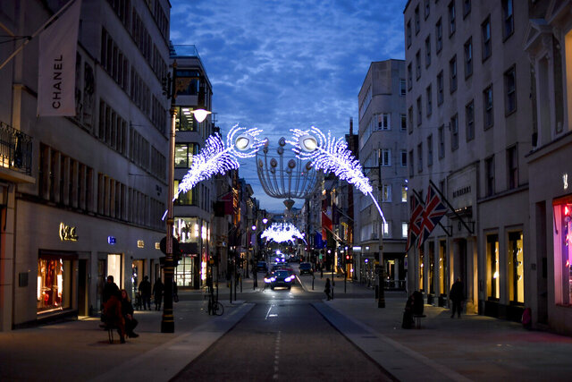 Christmas lights are lit up on New Bond Street in Mayfair, London, Tuesday, Nov. 24, 2020. Haircuts, shopping trips and visits to the pub will be back on the agenda for millions of people when a four-week lockdown in England comes to an end next week, British Prime Minister Boris Johnson said Monday. (AP Photo/Alberto Pezzali)