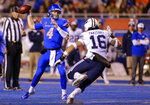 Boise State quarterback Brett Rypien (4) looks to throw down field as BYU linebacker Sione Takitaki (16) puts pressure on in the second half of an NCAA college football game, Saturday, Nov. 3, 2018, in Boise, Idaho. Boise State won 21-16 over BYU. (AP Photo/Steve Conner)