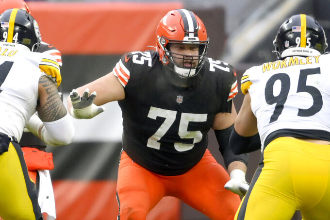 FILE - Cleveland Browns offensive guard Joel Bitonio (75) blocks in the third quarter an NFL football game against the Pittsburgh Steelers in Cleveland, in this Sunday, Jan. 3, 2021, file photo. Browns Pro Bowl left guard Joel Bitonio will be activated from the COVID-19 list Friday, Jan. 15, 2021, after missing last week's playoff win over Pittsburgh. (AP Photo/David Richard, File)