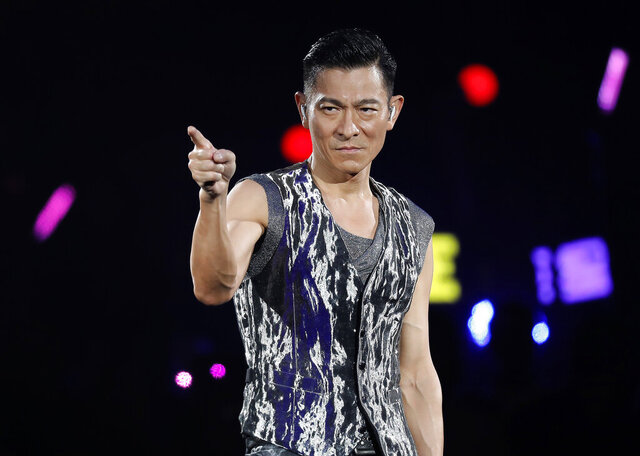 FILE- In this Dec. 15, 2018, file photo, Hong Kong singer Andy Lau performs during his concert in Hong Kong. Concerts and shows are being canceled, not just in China but across much of Asia, as a virus outbreak that has killed more than 300 people and reached more then 20 countries spooks the entertainment industry. (AP Photo/Vincent Yu, File)
