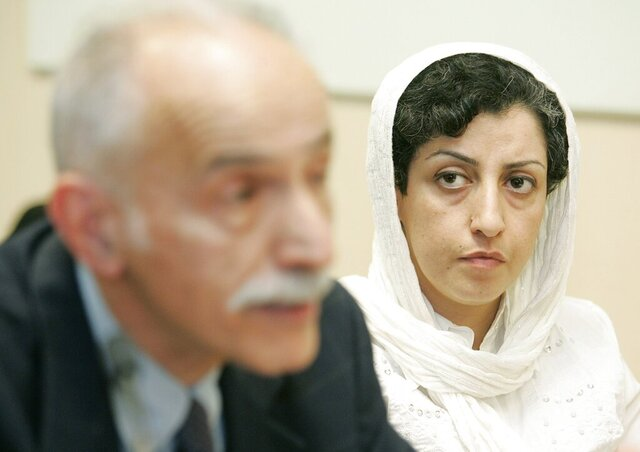 FILE - In this June 9, 2008 file photo, Iranian Narges Mohammadi, right, from the center for Human Rights Defenders, listens to Karim Lahidji, president of the Iranian league for the Defence of Human Rights, during a press conference on the Assessment of the Human Rights Situation in Iran, at the UN headquarters in Geneva, Switzerland. Iran released Mohammadi, a prominent human rights activist who campaigned against the death penalty, Iranian media reported Thursday, Oct. 8, 2020. The semiofficial ISNA news agency quoted judiciary official Sadegh Niaraki as saying that Narges Mohammadi was freed late Wednesday after serving 8 1/2 years in prison. (AP Photo/Keystone/Magali Girardin, File)