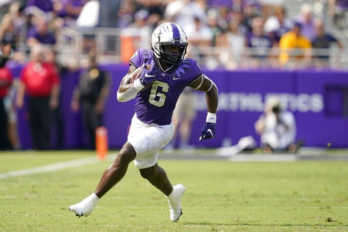 TCU running back Zach Evans (6) carries the ball for a long gain in the first half of an NCAA college football game against California in Fort Worth, Texas, Saturday, Sept. 11, 2021. (AP Photo/Tony Gutierrez)