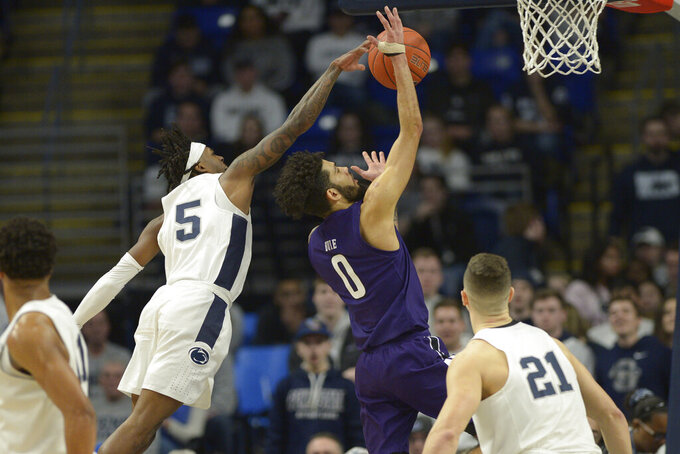 Penn State's Jamari Wheeler (5) blocks a shot by Northwestern's Boo Buie (0) during the first half of an NCAA college basketball game, Saturday, Feb. 15, 2020, in State College, Pa. (AP Photo/Gary M. Baranec)