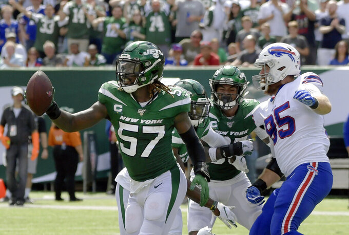 """FILE - In this Sunday, Sept. 8, 2019 file photo, New York Jets inside linebacker C.J. Mosley (57) celebrates after recovering a fumble during the first half of an NFL football game against the Buffalo Bills in East Rutherford, N.J. C.J. Mosley has been waiting a long time to feel this way again. After what he called a """"two-year hiatus"""" — one because of an injury, the other after opting out because of the coronavirus pandemic — the New York Jets middle linebacker is on the football field again and ready to show he can still be a game-wrecking playmaker. (AP Photo/Bill Kostroun)"""