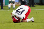 Arizona quarterback Grant Gunnell (17) rolls on the ground after going down with an injury on the first play from scrimmage during the first half of an NCAA college football game against UCLA on Saturday, Nov. 28, 2020, in Pasadena, Calif. (AP Photo/Marcio Jose Sanchez)