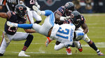 Detroit Lions running back Ty Johnson (31) is brought down by Chicago Bears cornerback Kyle Fuller (23), linebacker Danny Trevathan (59) and Leonard Floyd (94) during the first half of an NFL football game in Chicago, Sunday, Nov. 10, 2019. (AP Photo/Charles Rex Arbogast)