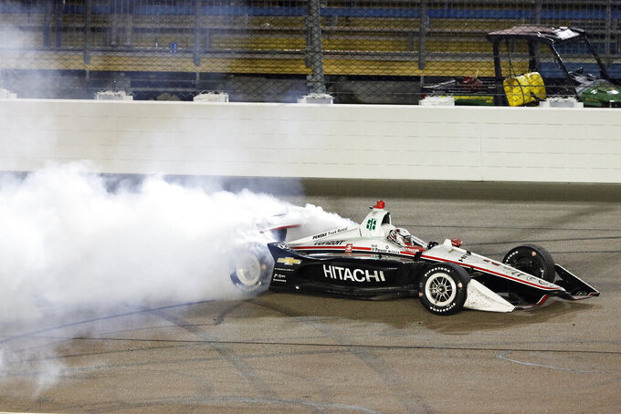 Josef Newgarden does a burnout after winning the IndyCar Series auto race Sunday, July 21, 2019, at Iowa Speedway in Newton, Iowa. (AP Photo/Charlie Neibergall)