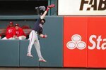 Washington Nationals' Adam Eaton leaps to catch a ball hit by St. Louis Cardinals' Tommy Edman during the eighth inning of Game 2 of the baseball National League Championship Series Saturday, Oct. 12, 2019, in St. Louis. (AP Photo/Jeff Roberson)
