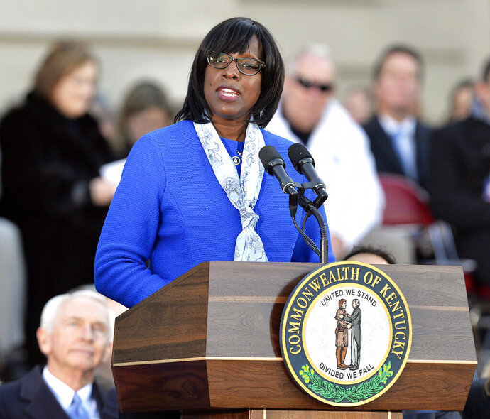 FILE - In this Dec. 8, 2015, file photo, Kentucky Lt. Gov. Jenean Hampton speaks to the spectators on the steps of the Kentucky Capitol following her public swearing in ceremony in Frankfort, Ky. Hampton has told the state's personnel secretary that she intends to defy a decision by Gov. Matt Bevin's administration to dismiss her deputy chief of staff. (AP Photo/Timothy D. Easley, File)