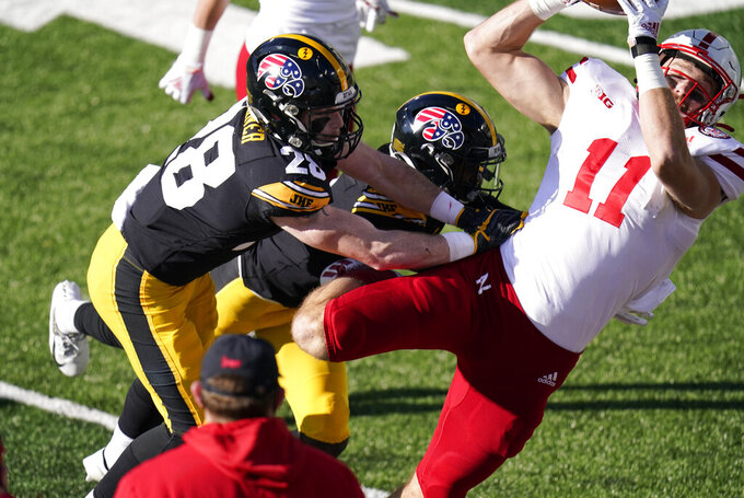 Nebraska tight end Austin Allen (11) catches a pass over Iowa defensive back Jack Koerner (28) during the first half of an NCAA college football game, Friday, Nov. 27, 2020, in Iowa City, Iowa. (AP Photo/Charlie Neibergall)
