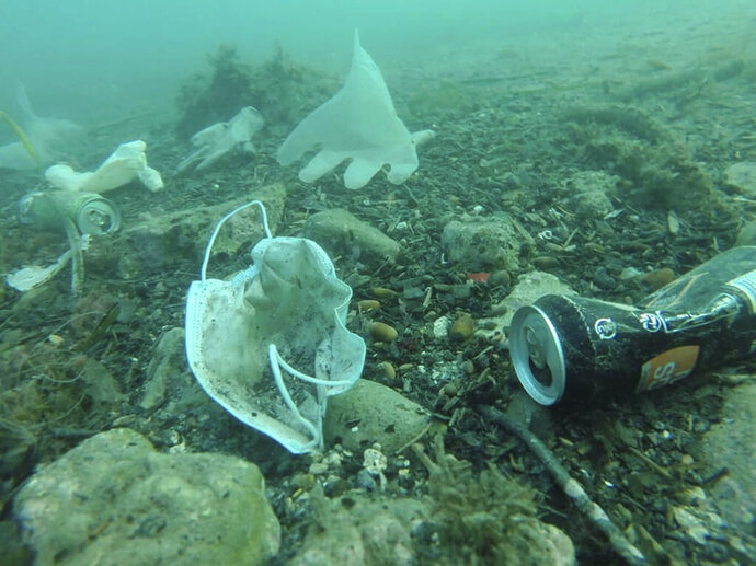 This photo taken on May 21, 2020 and providedWednesday May 27, 2020 by environmental group Operation Mer Propre (Operation Clean Sea) shows plastic gloves and face masks and other wastes off Antibes, southern France. A French environmental group found this virus-era detritus littering the Mediterranean floor near the French Riviera resort of Antibes, and is trying to raise awareness and clean it up. (Operation Mer Propre via AP)