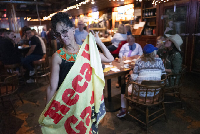 Recall proponent, Roxanne Hoge holds up a recall Gavin Newsom flag at an election party at Pineapple Hill Saloon & Grill in Los Angeles on Tuesday, Sept. 14, 2021. Hoge was among a small group of pro-recall voters who gathered to watch the results come in. The mom of four said she was hopeful Newsom would be ousted, but was realistic that the chances were slim in Democratic-controlled California. (AP Photo/Richard Vogel)
