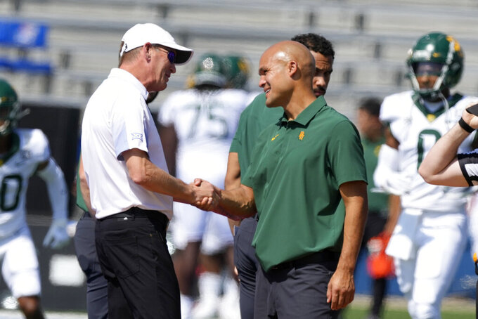 Kansas head coach Lance Leipold, left, shakes hands with Baylor head coach Dave Aranda, right, before an NCAA college football game in Lawrence, Kan., Saturday, Sept. 18 2021. (AP Photo/Orlin Wagner)