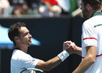 Italy's Fabio Fognini, left, is congratulated by Reilly Opelka of the U.S. after winning their first round singles match at the Australian Open tennis championship in Melbourne, Australia, Tuesday, Jan. 21, 2020. (AP Photo/Dita Alangkara)