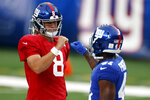 New York Giants quarterback Daniel Jones (8) fist-bumps a teammate prior to a scrimmage at the NFL football team's training camp in East Rutherford, N.J., Friday, Aug. 28, 2020. (AP Photo/Adam Hunger)
