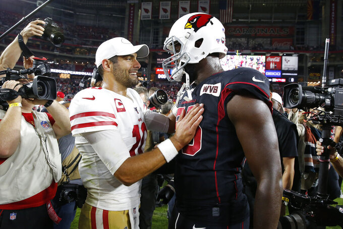 San Francisco 49ers quarterback Jimmy Garoppolo (10) greets Arizona Cardinals linebacker Chandler Jones (55) after an NFL football game, Thursday, Oct. 31, 2019, in Glendale, Ariz. The 49ers won 28-25. (AP Photo/Rick Scuteri)