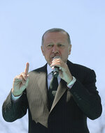 Turkey's President Recep Tayyip Erdogan addresses supporters of his ruling Justice and Development Party during a rally in Eregli, Turkey, Tuesday, March 19, 2019. Ignoring widespread criticism, Erdogan has again shown excerpts of a video taken by the attacker who killed 50 people in mosques in New Zealand at a campaign rally. (Presidential Press Service via AP, Pool)